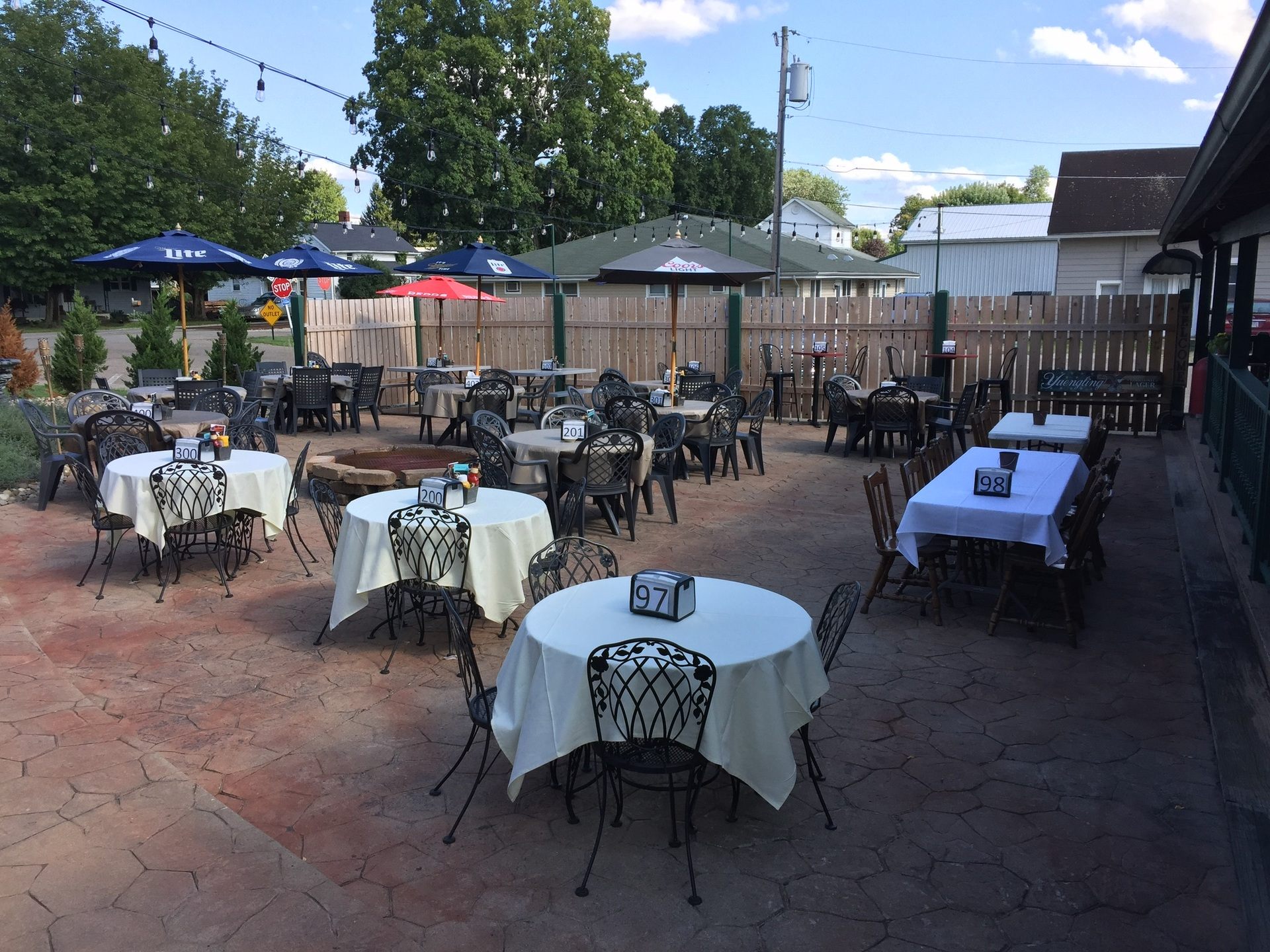 Enjoy Food and Drinks on our beautifully lit patio dining area.